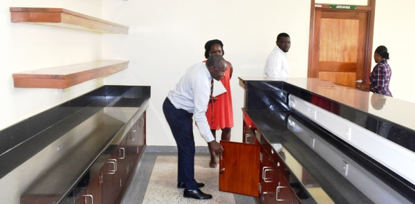 - Prof. Bernard Bashaasha, Principal-CAES inspects the Librarian's section in the new Library Space at the Graduate Training and Research Lab, MUARIK