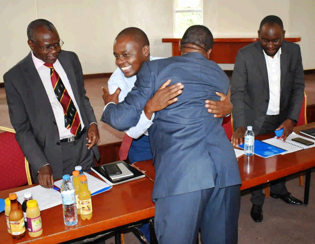 - The Dean Dr. Abel Atukwase hugs and thanks Prof. Kaaya for the job welldone
