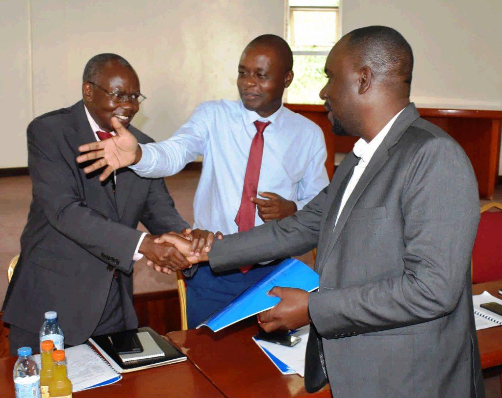 - The Principal Prof. Bernard Bashaasha congratulates Dr. Ivan Muzira Mukisa