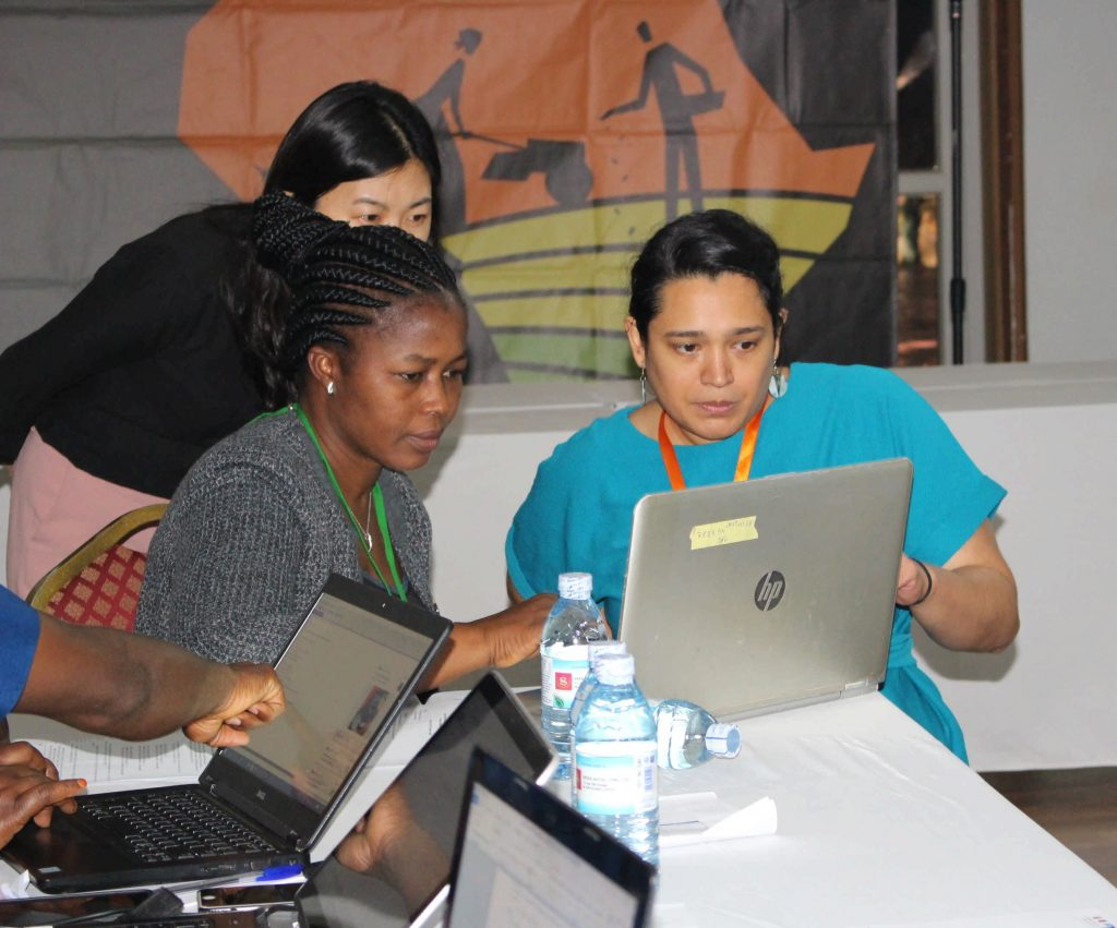 - Audrey Pereira (R) explaining to some of the participants