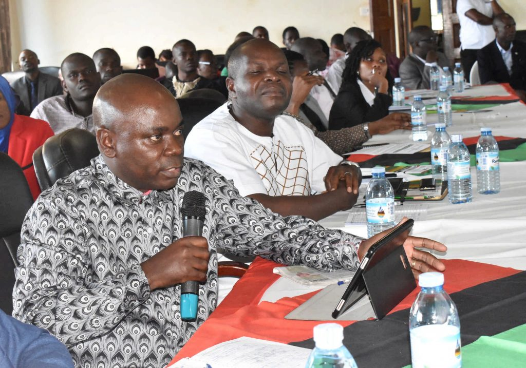 - One of Makerere's senior economist discussing during the policy dialogue
