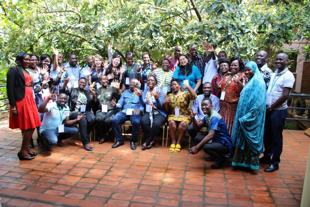 - Participants pose for a group photo