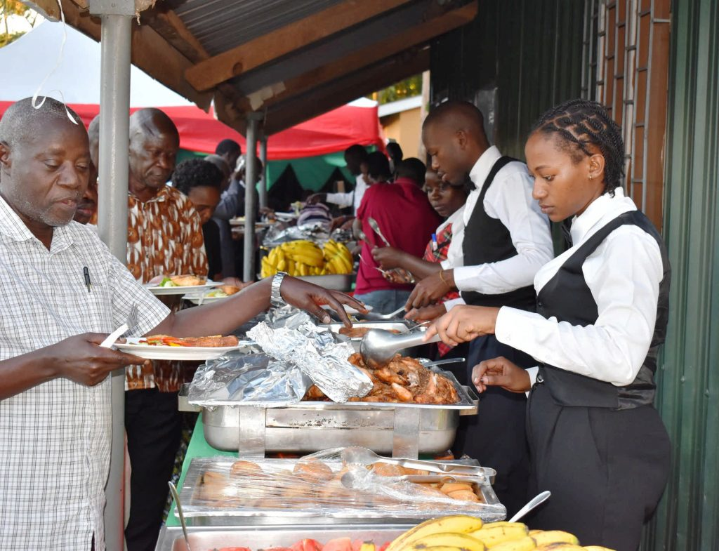 - Staff served food from the Guest House Makerere University