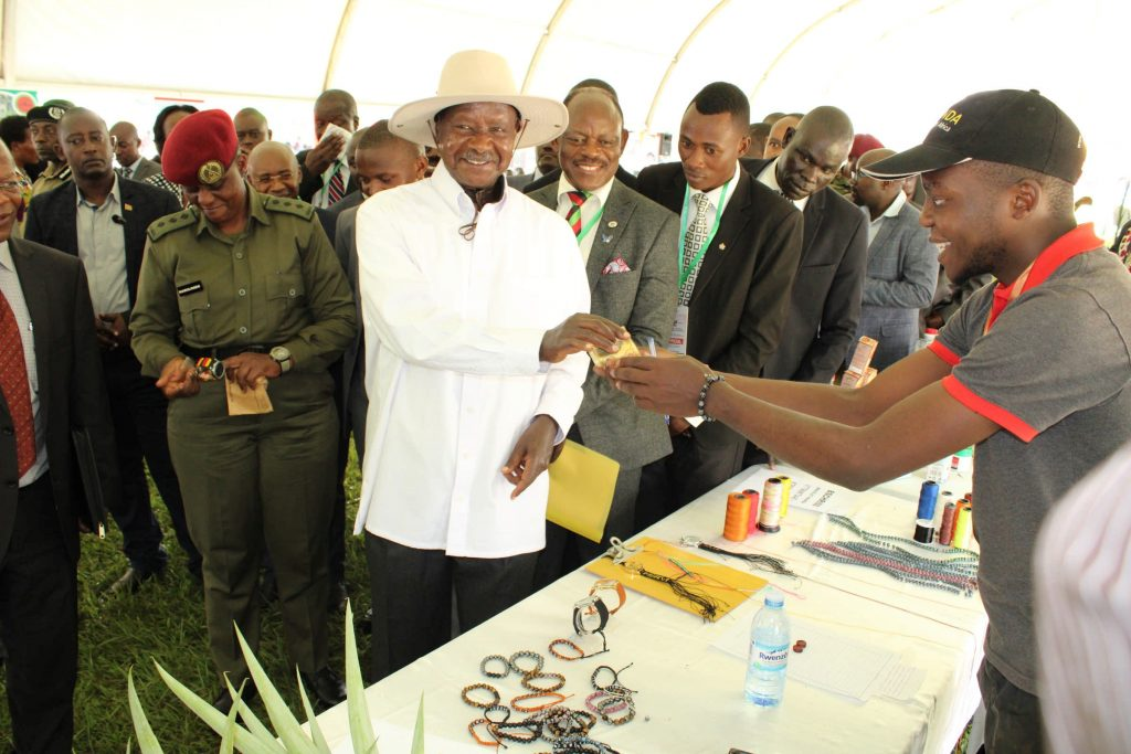 - One of the exhibitors receives a token of appreciation from the president during the Makerere University Agricultural Day and Exhibition
