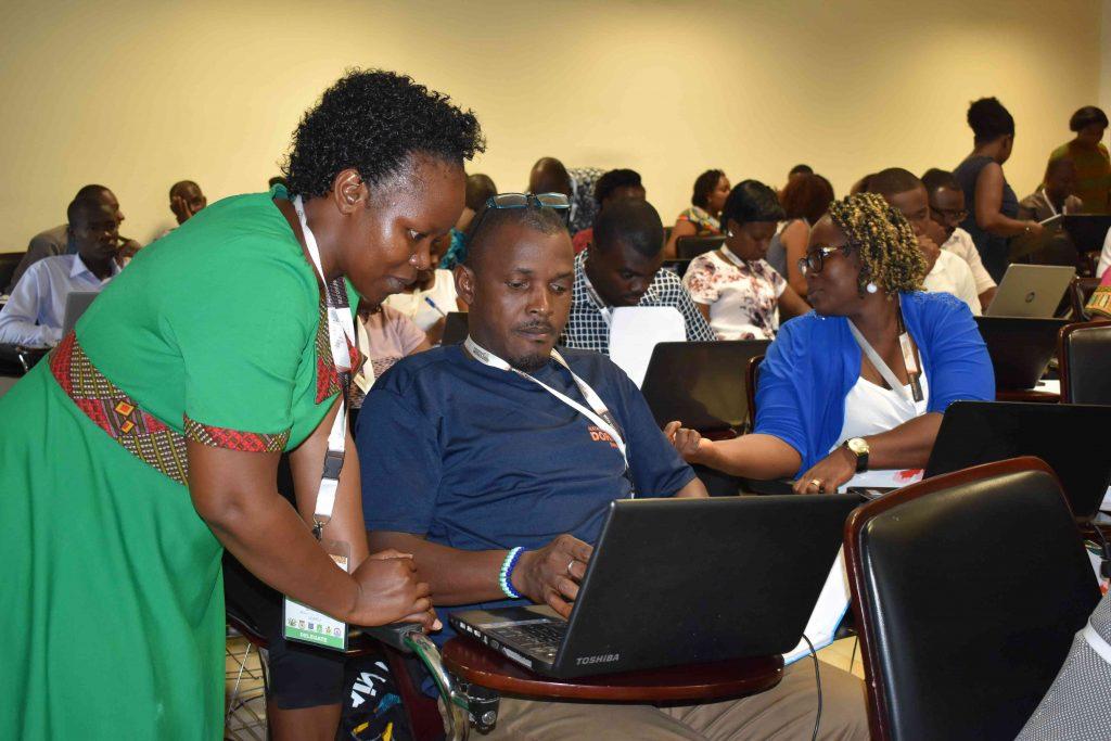 - Dr. Susan Balaba attending to students