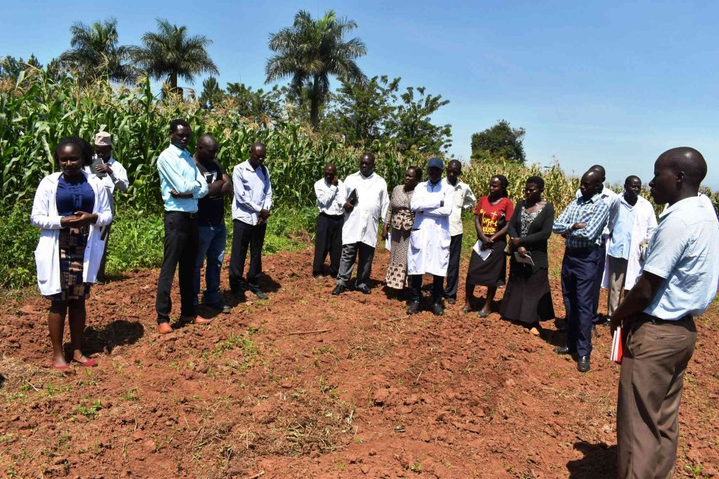 - Farmers on the visit to the study site at MUARIK
